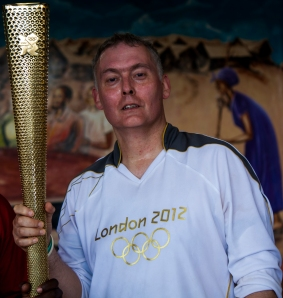 John McBride with the Olympic torch
