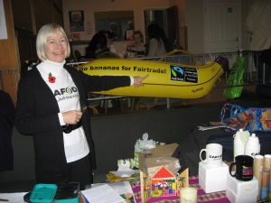 A parishoner stands with an inflatable banana to promote Fairtrade.