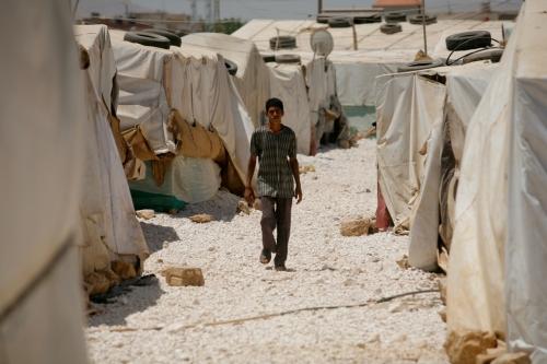 A boy walks at Dalhmieh Syrian refugee camp near Zahle, Bekaa valley, Lebanon - CAFOD.