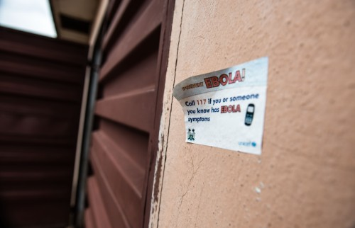 Stickers mark houses where Caritas distributed soap and advice in September.
