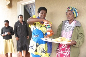 Feza and Verene opening marmalade given by St Georges Parish