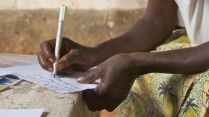Rwanda- writing in a journal