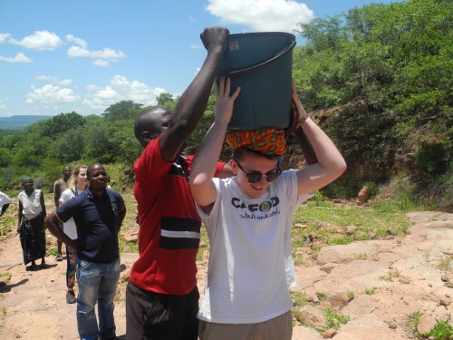 Kieron carrying water