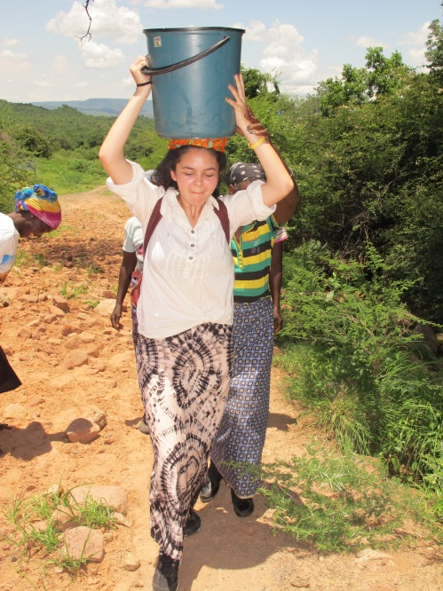Leila carrying water