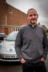 Father David with a Nissan Leaf