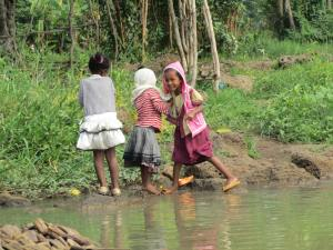 CAFOD Children in Ethiopia play by the side of a river