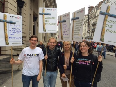 Chris Bird (far left) and friends march in London in solidarity with refugees.