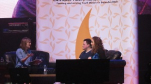 Leah and Ryan being interviewed by Sarah Burrows onstage at Flame.