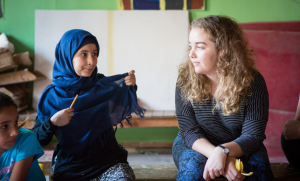 Leah in Lebanon speaking to a young refugee.